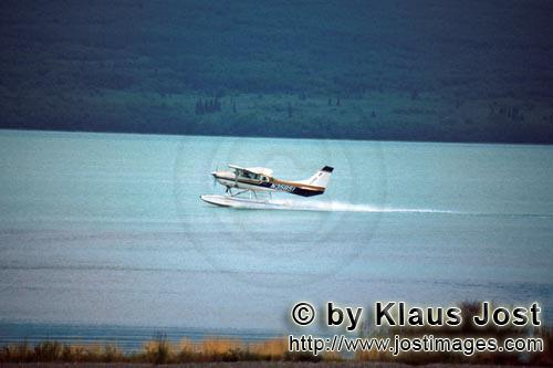 Floatplane/Bush plane/Alaska        Water plane takes off         With the Bush plane, it is