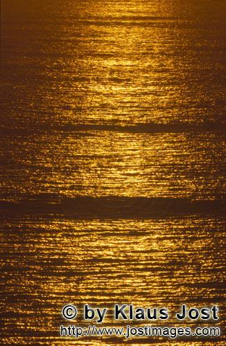 Walker Bay/Western Cape/South Africa        Golden sea surface at sunset