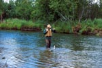 Fisherman with a rainbow trout