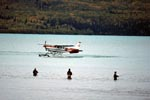 Bush plane and Fisherman