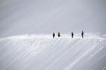 Hiking on the panoramic trail through the snow-covered mountains