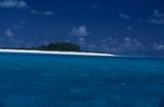 Island in the Pacific with snow-white beach