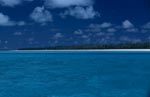 Blue lagoon with Midway Island