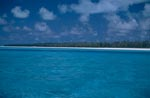 Midway Island with lagoon and clouds sky