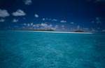 South Sea island in the endless blue of the ocean