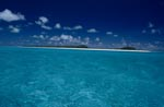 South Sea island with white beach and turquoise blue sea