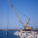 Placing dolosse on North Breakwater